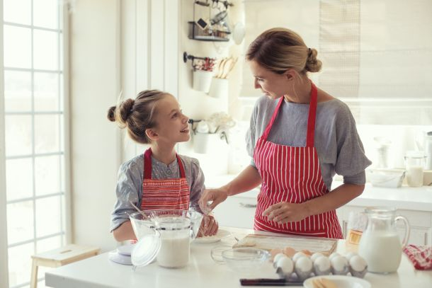 44715931 - mom with her 9 years old daughter are cooking in the kitchen to mothers day, lifestyle photo series in bright home interior