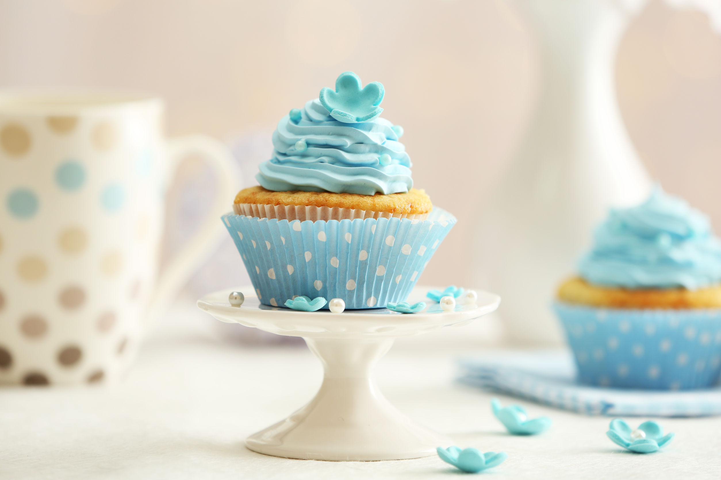 39135950 - delicious cupcakes on table on light background